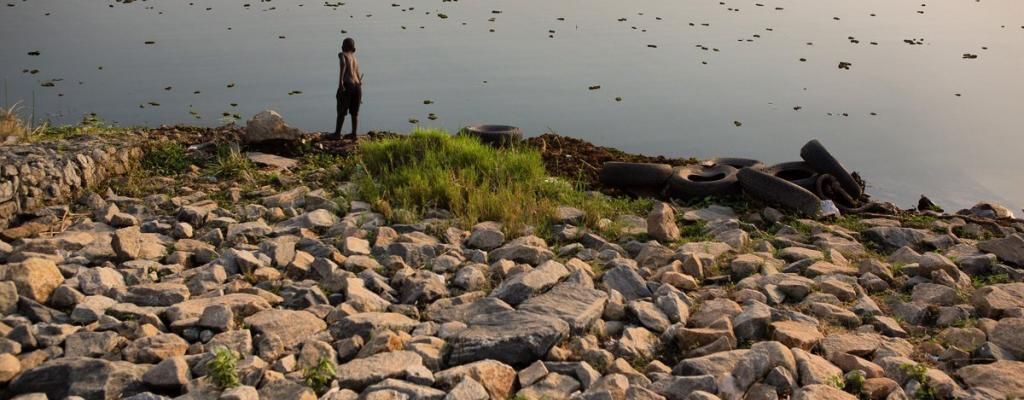A boy is seen fishing by the shores of River Nile in Moyo district